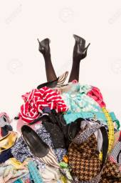 48364823-woman-legs-reaching-out-from-a-big-pile-of-clothes-and-accessories-woman-buried-under-an-untidy-clut